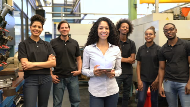 portrait of a businesswoman with factory workers - production line stock videos & royalty-free footage