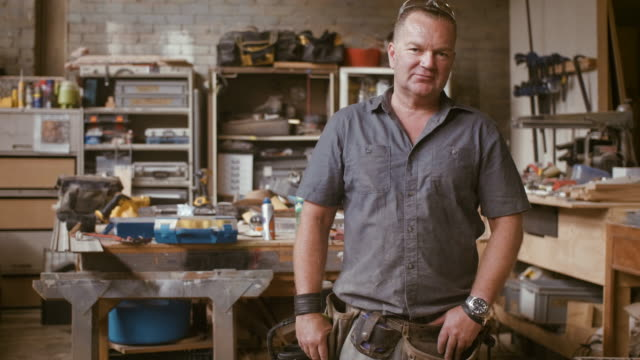 portrait of a carpenter (slow motion) - craftsman stock videos and b-roll footage