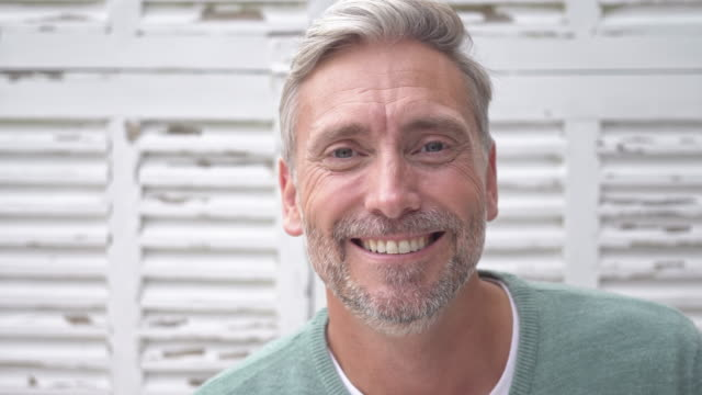 portrait of a caucasian mature man at home - smiling stock videos & royalty-free footage
