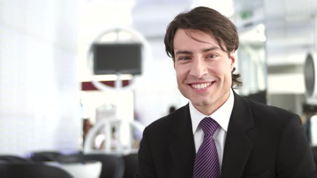 HD: Portrait Of A Cheerful Businessman