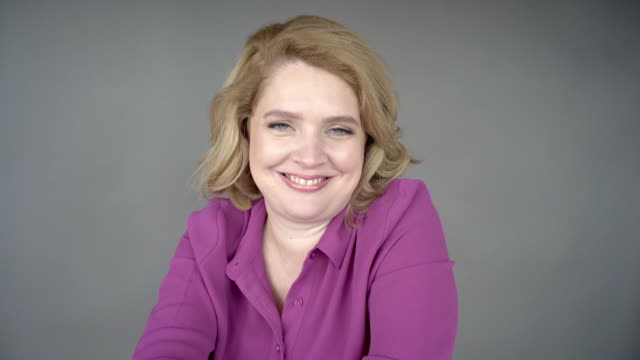 a portrait of a cheerful lady. - one mid adult woman only stock videos & royalty-free footage