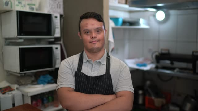 portrait of a chef standing with arms crossed in a commercial kitchen - persons with disabilities stock videos & royalty-free footage