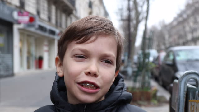 portrait of a child with a dental device on the street - brace stock videos and b-roll footage