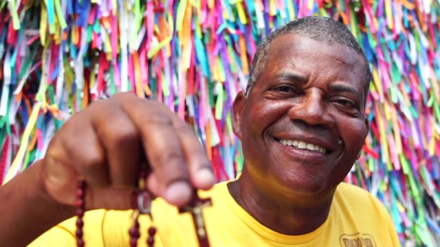 portrait of a christian man showing the crucifix - bahia state stock videos and b-roll footage