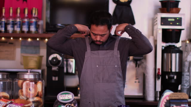 portrait of a coffee shop owner - apron stock videos & royalty-free footage