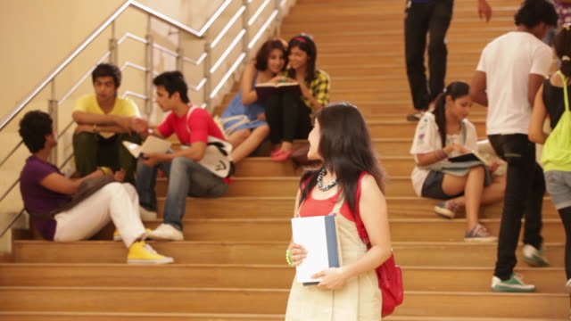 portrait of a college student standing in front of stairs  - teenagers only stock videos & royalty-free footage
