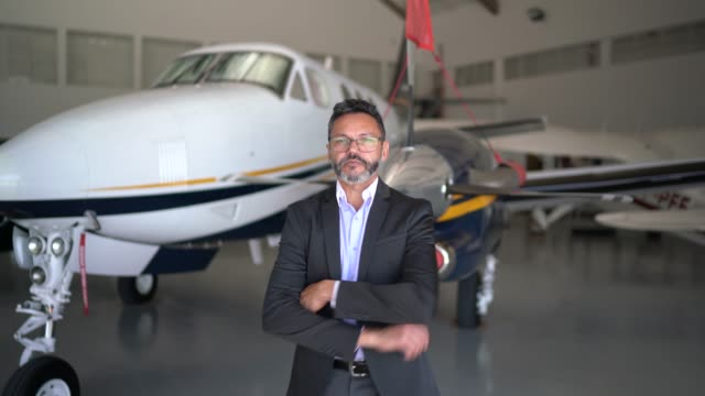 portrait of a confident man in a hangar - aerospace stock videos & royalty-free footage