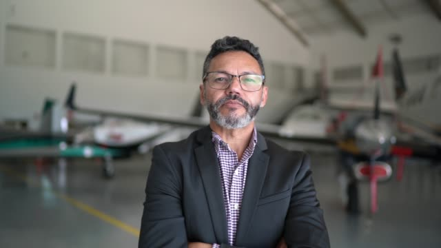 portrait of a confident man in a hangar - chairperson stock videos & royalty-free footage