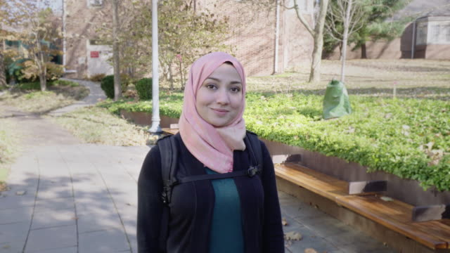 portrait of a confident muslim university student - hijab stock videos and b-roll footage
