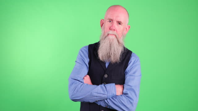 portrait of a confident senior man - green background stock videos & royalty-free footage