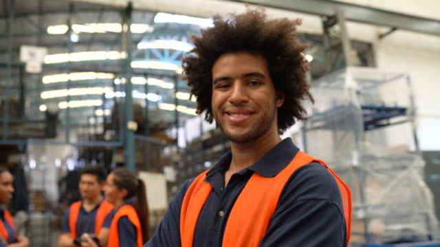portrait of a confident warehouse worker - warehouse stock videos & royalty-free footage