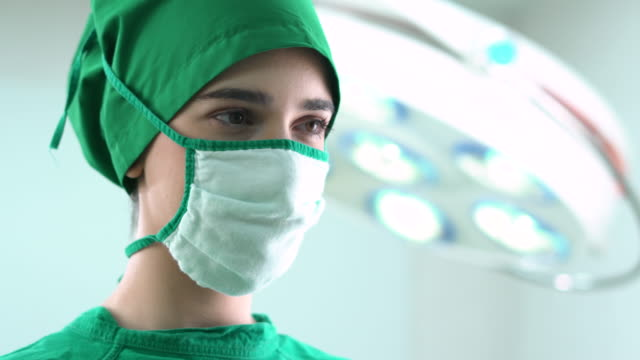 portrait of a confident young female surgeon - surgical cap stock videos & royalty-free footage