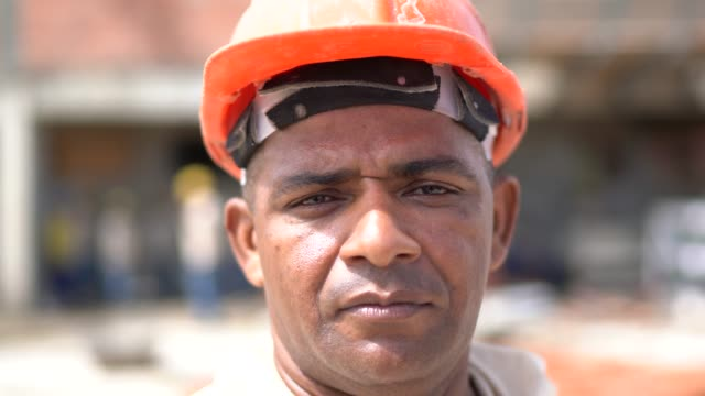 portrait of a construction worker in a construction site - health and safety stock videos & royalty-free footage