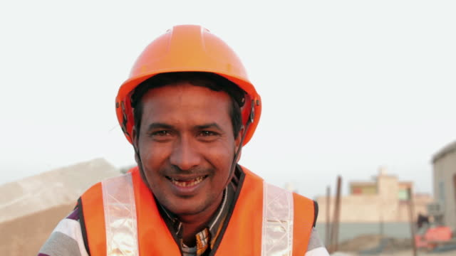 portrait of a construction worker smiling, delhi, india - construction worker stock videos and b-roll footage