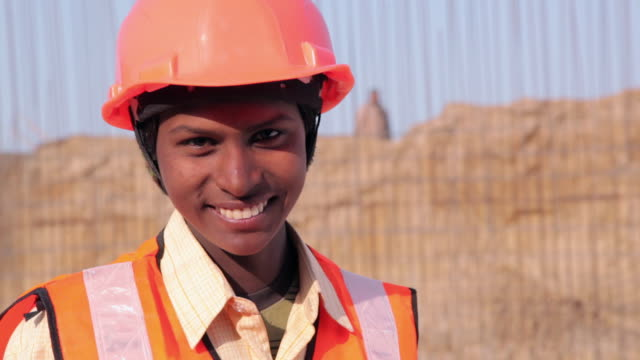 Portrait of a construction worker smiling, Delhi, India