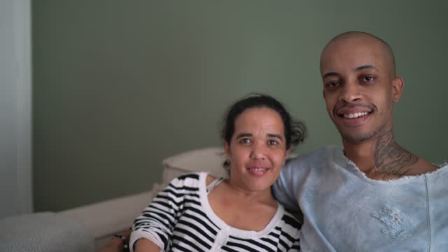 portrait of a couple at home - including a dwarfism woman - persons with disabilities stock videos & royalty-free footage