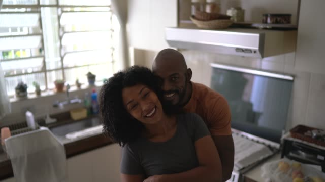 portrait of a couple at kitchen - afro stock videos & royalty-free footage