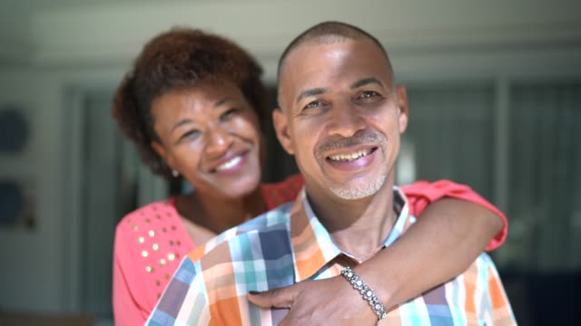 portrait of a couple embracing at home - mature couple stock videos & royalty-free footage