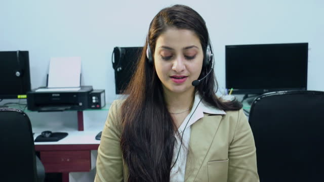 Portrait of a Customer care representative talking on a headset in the office