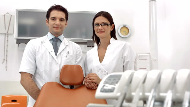 hd dolly: portrait of a dentist and dental assistant - dentist's office stock videos and b-roll footage