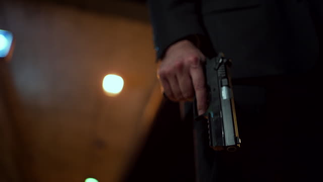 portrait of a detective in black suit with a gun - weapon stock videos & royalty-free footage