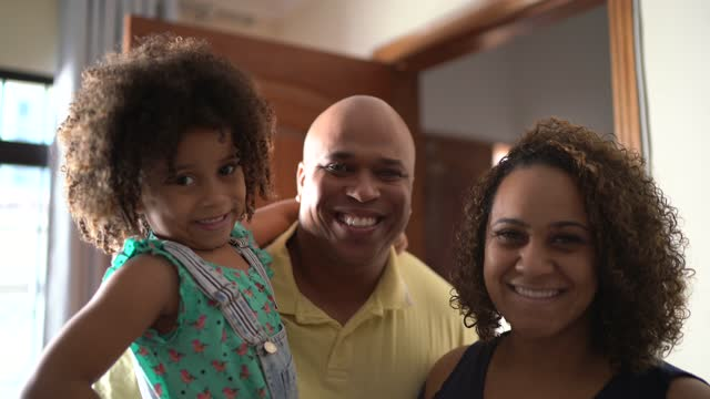portrait of a family at home - arm around stock videos & royalty-free footage