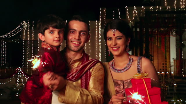 portrait of a family celebrating diwali festival, delhi, india - two parents stock videos & royalty-free footage