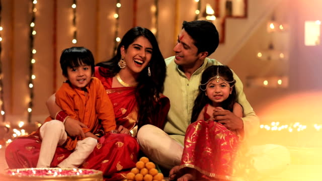portrait of a family celebrating diwali festival in the home, delhi, india - votive candle stock videos and b-roll footage