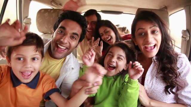portrait of a family enjoying in a car  - enjoyment stock videos & royalty-free footage