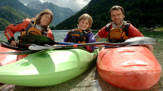 hd: portrait of a family in kayaks - leisure activity stock videos & royalty-free footage