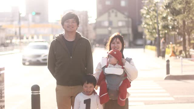 portrait of a family of four - toothy smile stock videos & royalty-free footage