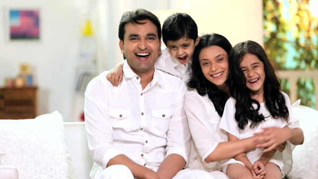 Portrait of a family smiling in home, Delhi, India