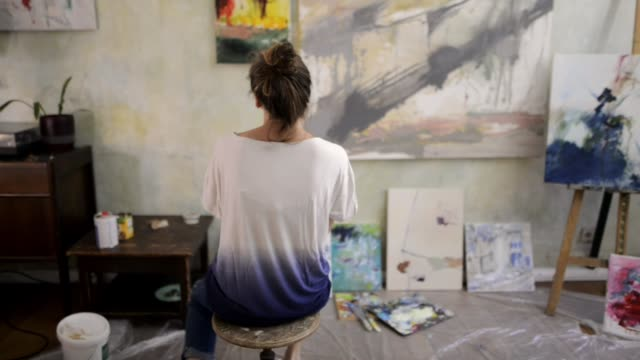 portrait of a female artist in her studio. - art studio stock videos & royalty-free footage