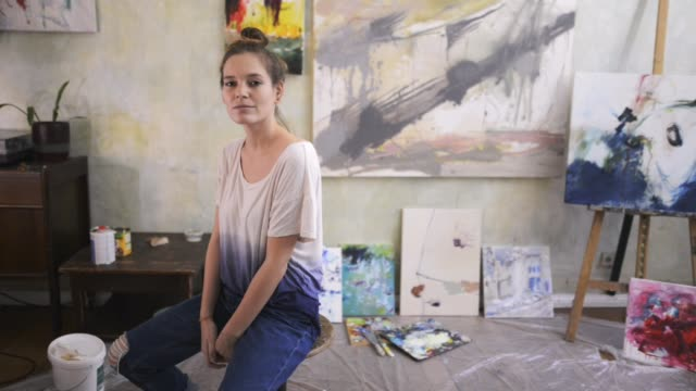 portrait of a female artist. - paintings stock videos & royalty-free footage