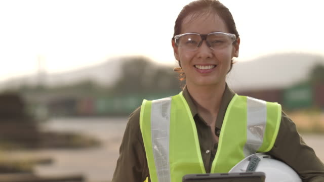 portrait of a female at construction site - jumpsuit stock videos & royalty-free footage
