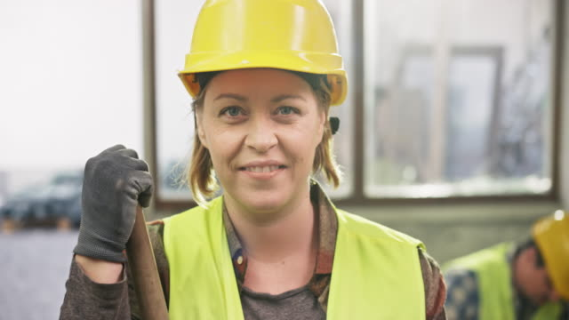 portrait of a female construction worker - construction worker stock videos and b-roll footage