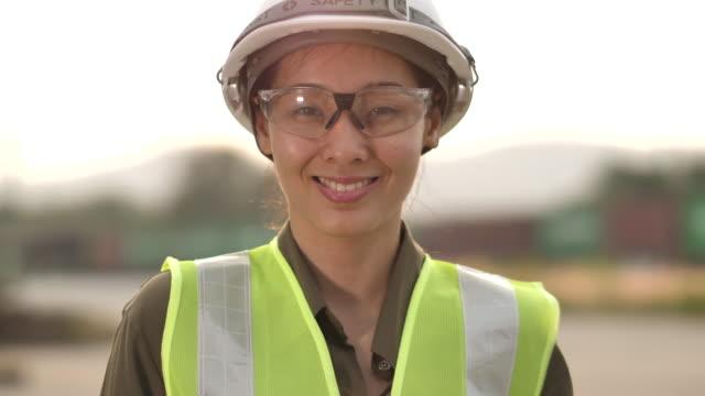 portrait of a female engineer - work helmet stock videos & royalty-free footage