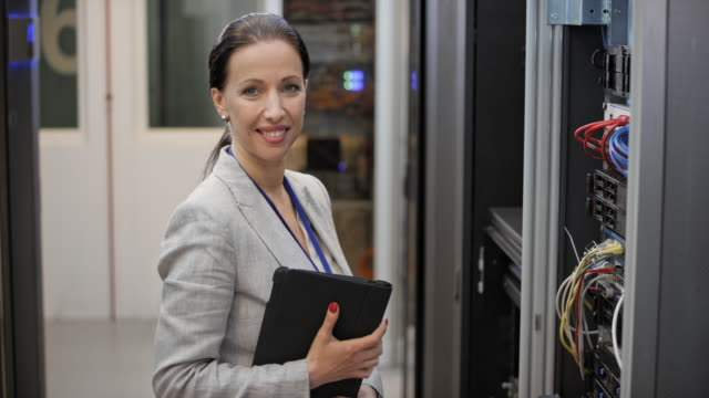 ds portrait of a female engineer working in the server room - it professional stock videos and b-roll footage