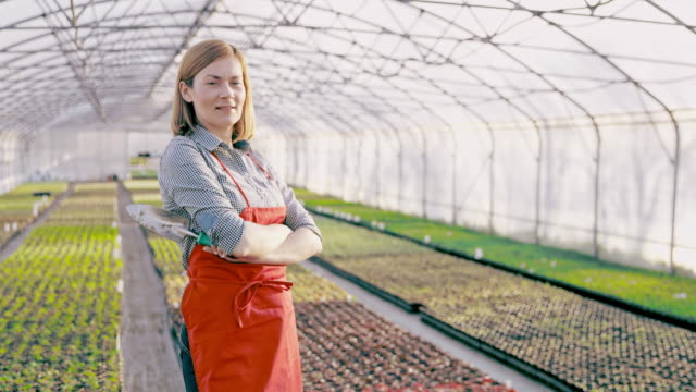 DS Portrait of a female gardener in the greenhouse