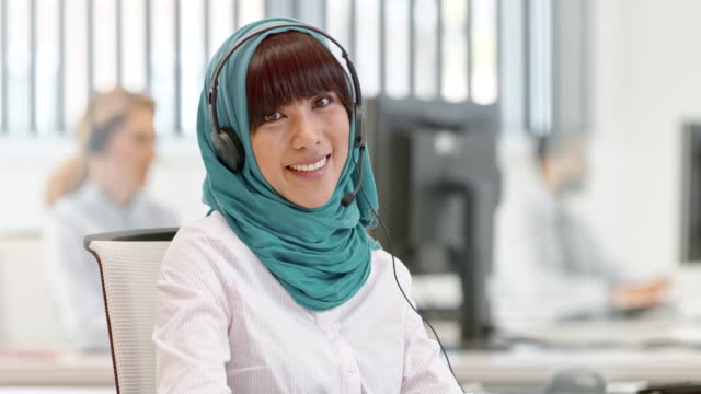 DS Portrait of a female Muslim call center operator