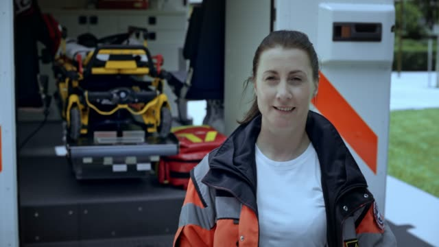 portrait of a female paramedic - paramedic stock videos & royalty-free footage