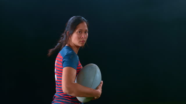slo mo portrait of a female rugby player holding a ball - rugby stock videos & royalty-free footage