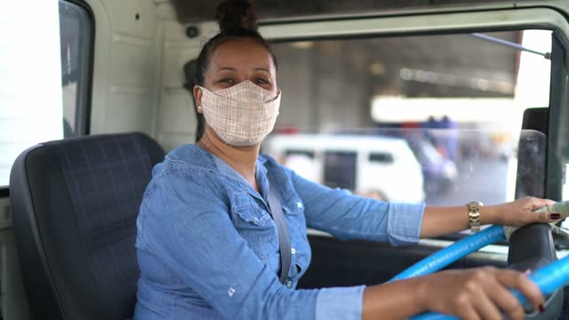 portrait of a female truck driver using face mask - females stock videos & royalty-free footage