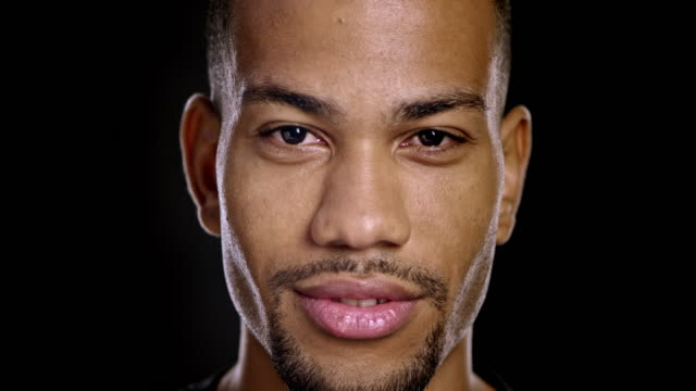 portrait of a flirting young african-american male - handsome people stock videos & royalty-free footage