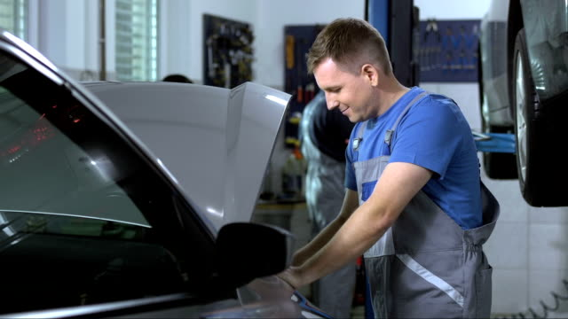 portrait of a friendly mechanic - repair shop stock videos & royalty-free footage