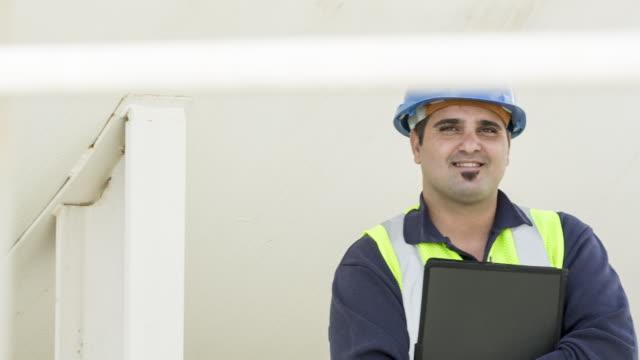 TS Portrait of a fuel depot worker