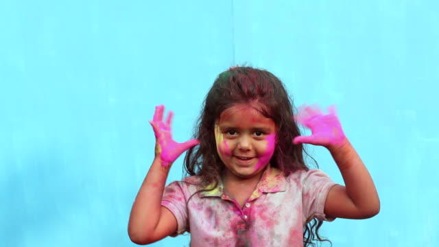 portrait of a girl celebrating holi festival - face paint stock videos & royalty-free footage