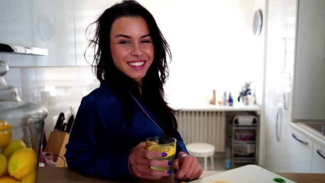portrait of a girl in pajamas holding a glass of lemonade - lemonade stock videos and b-roll footage