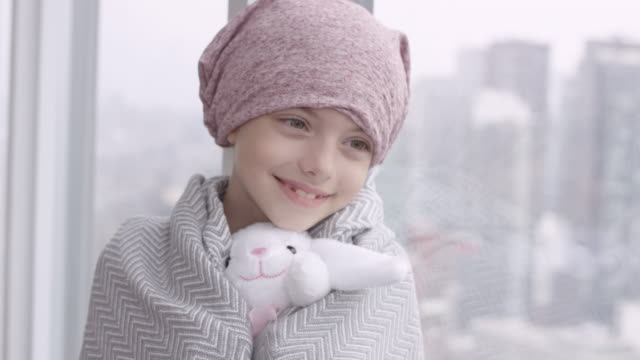 portrait of a girl with cancer holding a stuffed toy - survival stock videos & royalty-free footage