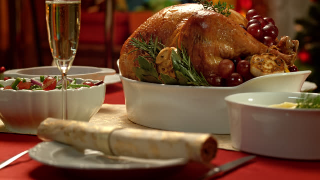 portrait of a golden and crisp turkey on a christmas table - table stock videos & royalty-free footage